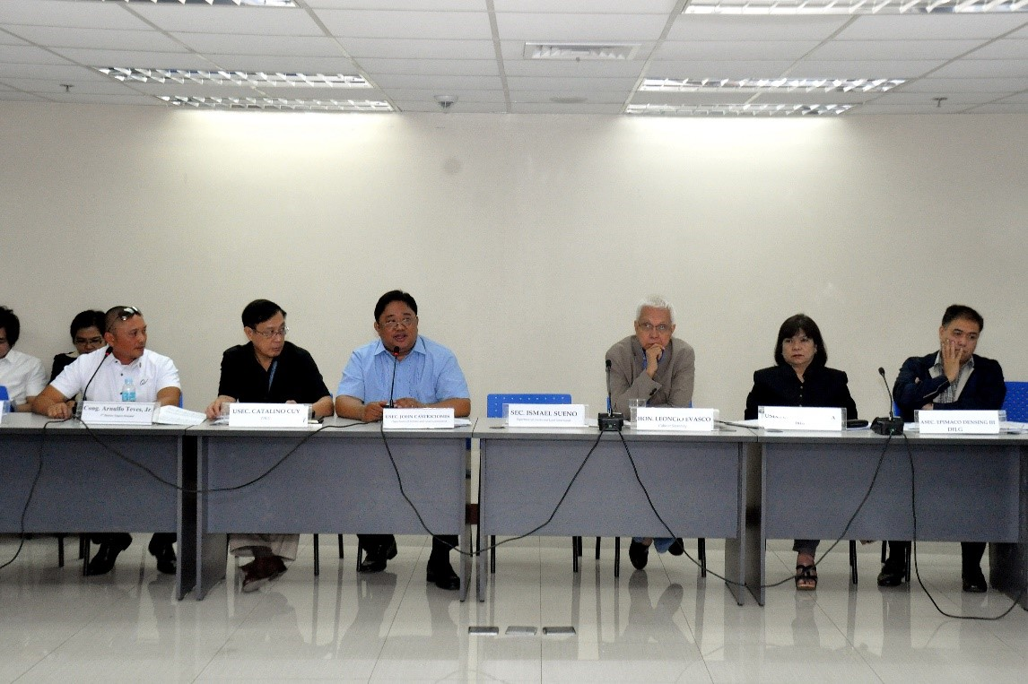 DILG Undersecretary John R. Castriciones (in blue) presided the inter-agency meeting on drug rehabilitation program held at the DILG-NAPOLCOM Center.  To his right are  Secretary to the Cabinet Leoncio Evasco, DILG Undersecretary Emily Padilla, and Assistant Secretary Epimaco Densing. To his left are DILG Undersecretary Catalino Cuy and Congressman Arnulfo Teves, Jr. of Negros Occidental.